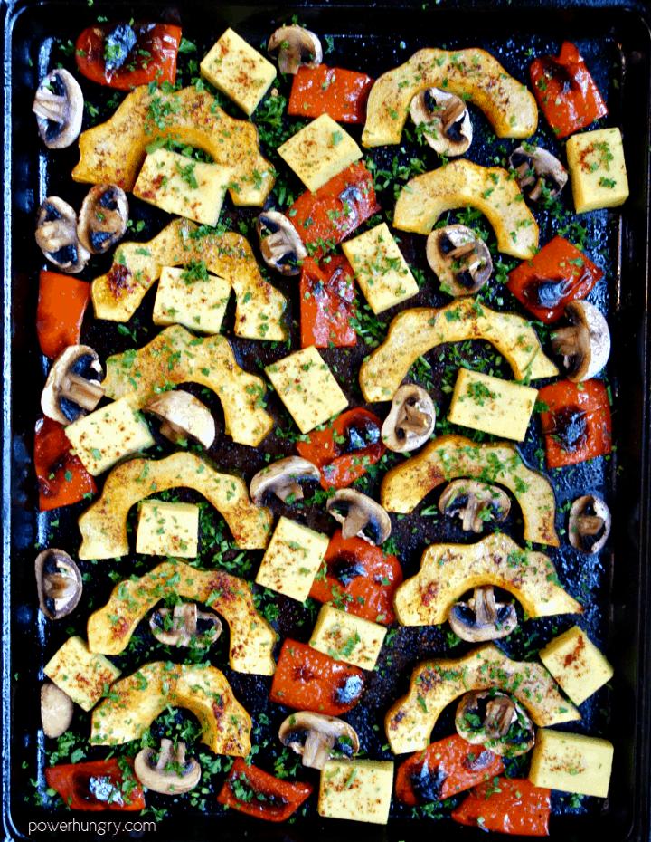 overhead shot of acorn squash sheet pan dinner with Burmese tofu