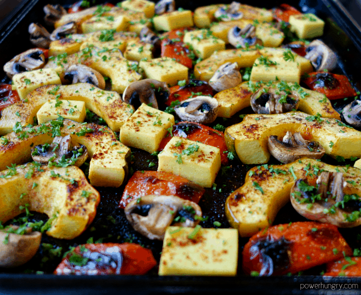 close up of acorn squash sheet pan dinner with mushrooms and peppers